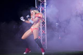 Kelly Campbell, of the Las Vegas SIN, makes her enterance on the field before going against Green Bay Chill, Thursday May 15, 2014. The SIN beat Green Bay 34 to 24 at Thomas & Mack Center, their first win of the Legends Football League season.