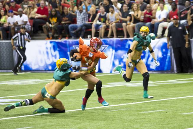 Danika Brace, of the Las Vegas SIN, makes a running play against Green Bay Chill at Thomas & Mack Center, Thursday May 15, 2014. The SIN beat Green Bay 34 to 24, their first win of the Legends Football League season.