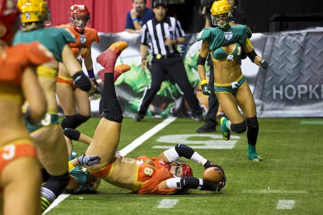 Danika Brace, of the Las Vegas SIN, completes a pass before being tackled by Green Bay Chill at Thomas & Mack Center, Thursday May 15, 2014. The SIN beat Green Bay 34 to 24, their first win of the Legends Football League season.