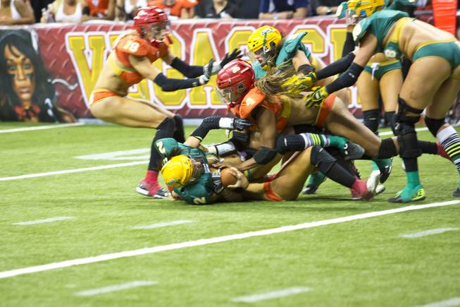 Green Bay Chill clashes with Las Vegas SIN, orange, during their game at Thomas & Mack Center, Thursday May 15, 2014. The SIN beat Green Bay 34 to 24, their first win of the Legends Football League season.