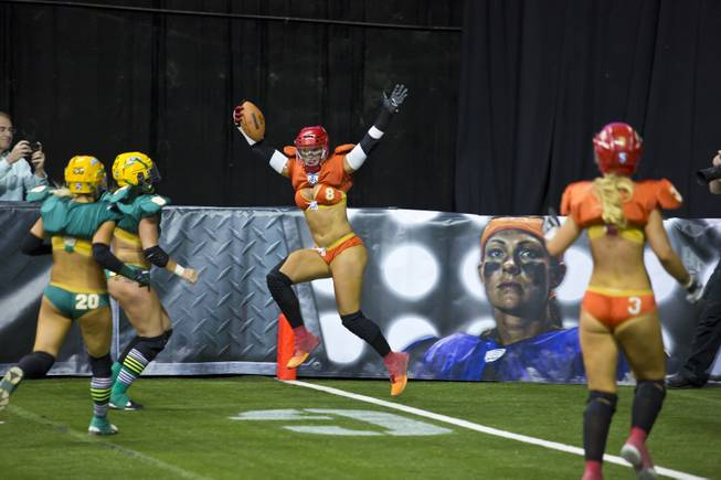 Danika Brace, of the Las Vegas SIN, celebrates after scoreing a touchdown against Green Bay Chill, Thursday May 15, 2014. The SIN beat Green Bay 34 to 24 at Thomas & Mack Center, their first win of the Legends Football League season.