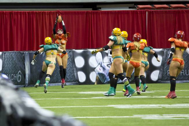 Cynthia Schmidt, of the Las Vegas SIN, scores a touchdown against Green Bay Chill, Thursday May 15, 2014. The SIN beat Green Bay 34 to 24 at Thomas & Mack Center, their first win of the Legends Football League season.