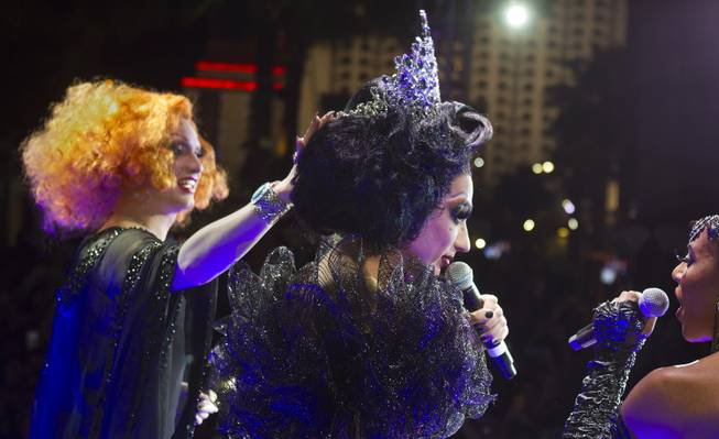 Cast member Bianca Del Rio has her crown adjusted by season five winner Jinkx Monsoon after being declared the winner of season six of 'RuPaul's Drag Race' during a viewing party for the show's finale at the New Tropicana  on Monday, May 19, 2014.