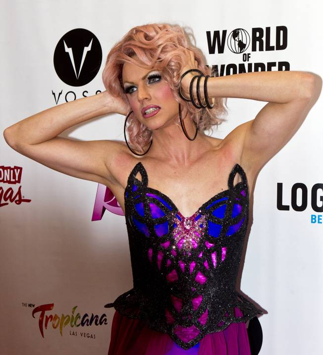 """RuPaul's Drag Race"" cast member Courtney Act strikes a pose on the Red Carpet for the Season 6 Finale Viewing Party featuring a live screening of the show at The New Tropicana on Monday, May 19, 2014."