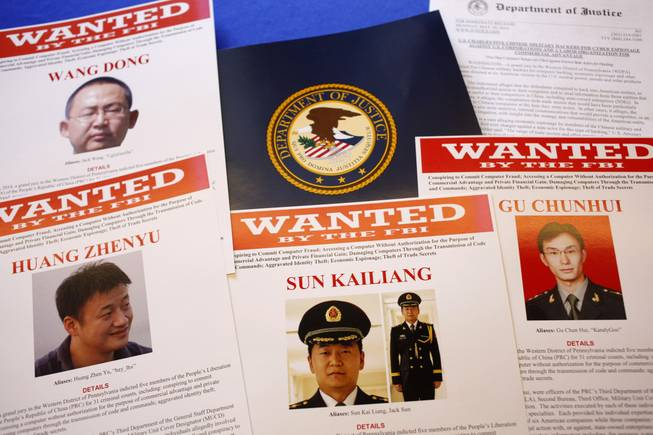 Press materials are displayed on a table of the Justice Department in Washington, Monday, May 19, 2014, before Attorney General Eric Holder was to speak at a news conference. Holder was announcing that a U.S. grand jury has charged five Chinese hackers with economic espionage and trade secret theft, the first-of-its-kind criminal charges against Chinese military officials in an international cyber-espionage case.