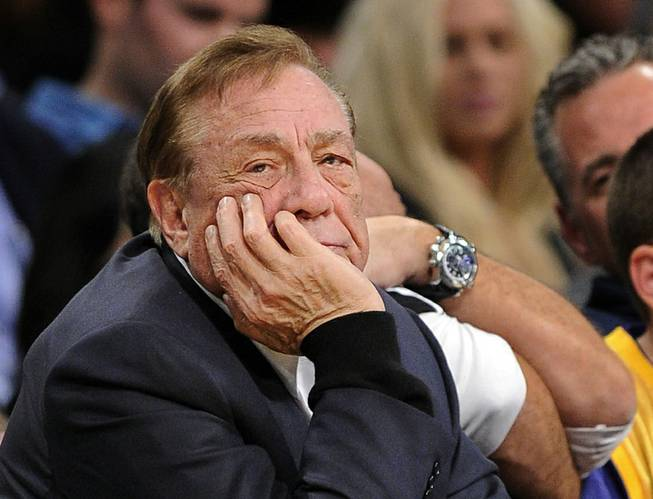 In this Feb. 25, 2011, file photo, Los Angeles Clippers owner Donald Sterling watches the first half of their NBA game against the Los Angeles Lakers in Los Angeles.