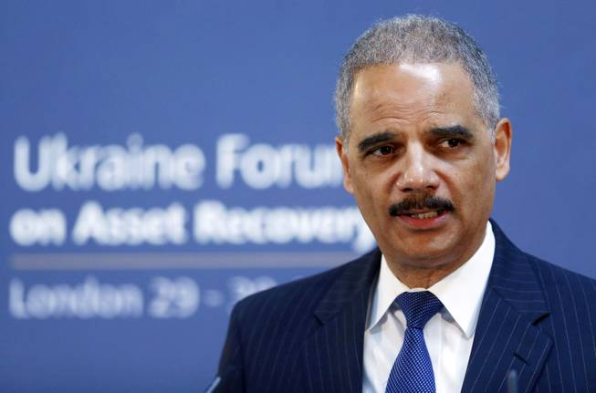 In this April 29, 2014, file photo, U.S. Attorney General Eric Holder speaks at the Ukraine Forum on Asset Recovery in central London.