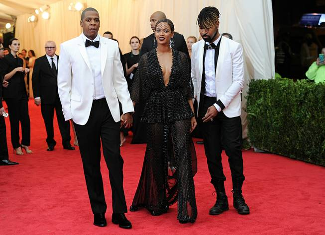 "In this Monday, May 5, 2014, photo, Jay Z and Beyonce arrive at the Metropolitan Museum of Art's Costume Institute benefit gala celebrating ""Charles James: Beyond Fashion"" in New York."