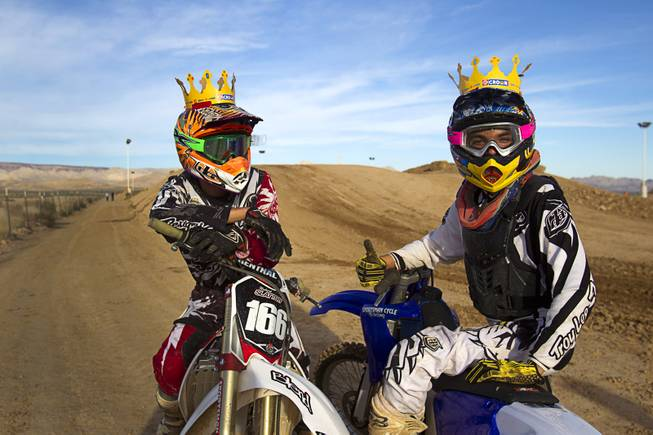 Robert Slattery, 25, of Henderson and Nick Rodriguez of Las Vegas pose at the Sandy Valley MX motocross course in Sandy Valley Thursday, May 15, 2014. The pair are wearing crowns as they went to Burger King before coming to the track, the said.