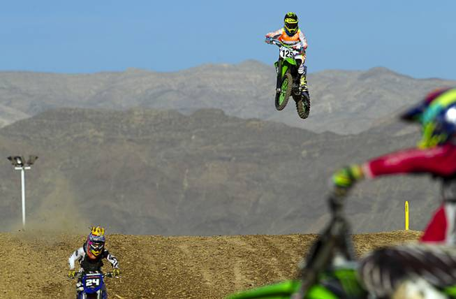 David Kartes, 17, of Las Vegas files off a jump at the Sandy Valley MX motocross course in Sandy Valley Thursday, May 15, 2014.