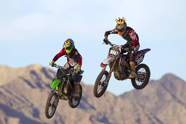 Eddie Chittock, left, 23, of Las Vegas, and Robert Slattery, 25, of Henderson fly off a jump at the Sandy Valley MX motocross course in Sandy Valley Thursday, May 15, 2014.