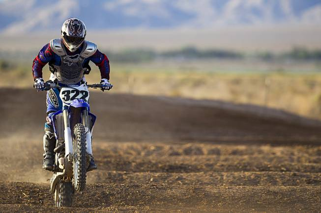 Randy Wattles, 49, of Summerlin goes through whoop-de-doos at the Sandy Valley MX motocross course in Sandy Valley Thursday, May 15, 2014.
