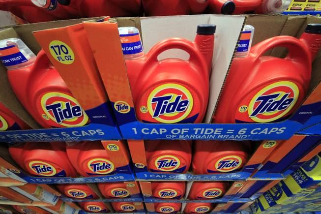 In this Tuesday, Jan. 21, 2014, file photo, Tide detergent is displayed at a Costco store in Robinson Township, Pa. Proctor & Gamble reports quarterly earnings on Friday, Jan. 24, 2014.