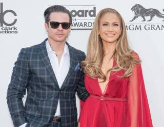 Casper Smart and Jennifer Lopez arrive at the 2014 Billboard Music Awards at MGM Grand Garden Arena on Sunday, May 18, 2014, in Las Vegas.