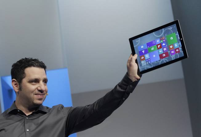 Panos Panay, Microsoft's vice president for surface computing, introduces the Surface Pro 3 tablet device at a media preview, Tuesday, May 20, 2014, in New York. The device will have a screen measuring 12 inches diagonally, up from 10.6 inches in previous models. Microsoft says it's also thinner and faster than before.