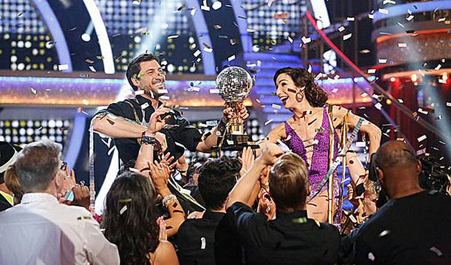 "Maksim Chmerkovskiy and ice dancer Meryl Davis celebrate their Season 18 victory on ABC's ""Dancing With the Stars"" on Tuesday, May 20, 2014."