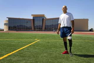 Mstr. Sgt. Christopher Aguilera poses at the outdoor track at Nellis Air Force Base Wednesday, May 21, 2014. Aguilera was selected as one of 40 Air Force members to participate in the 2014 London Invictus Games for wounded veterans. Aguilera was injured when his helicopter was shot down in Afghanistan in 2010.
