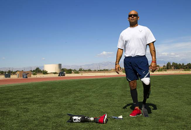 Mstr. Sgt. Christopher Aguilera poses before a run at the outdoor track at Nellis Air Force Base Wednesday, May 21, 2014. Aguilera was selected as one of 40 Air Force members to participate in the 2014 London Invictus Games for wounded veterans. Aguilera was injured when his helicopter was shot down in Afghanistan in 2010.
