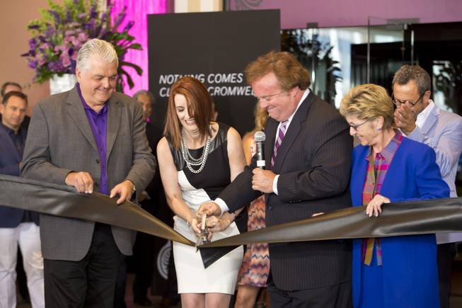 Clark Counry Commissioner Steve Sisolak, Karie Hall, VP & General Manager of The Cromwell, Gary Loveman, ceo and president of Caesars Entertainment, and Clark Counry Commissioner Chris Giunchigliani cut the ribbon during the opening ceremony of The Cromwell, Wednesday May 21, 2014. The Cromwell is the first stand-alone boutique hotel located on the Las Vegas Strip.