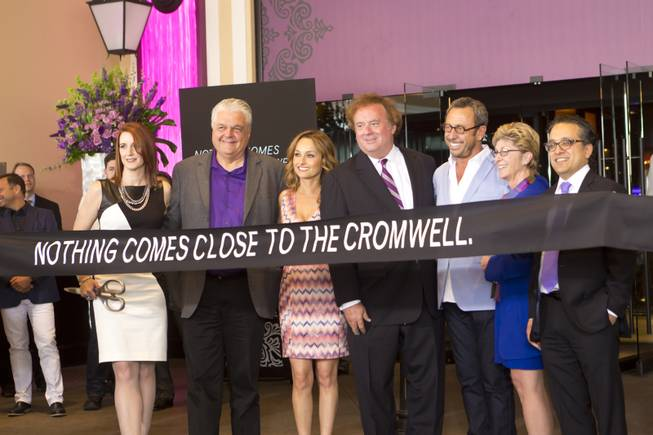 From left: Karie Hall, VP & General Manager of The Cromwell, Clark Counry Commissioner Steve Sisolak, Giada De Laurentiis, Gary Loveman, ceo and president of Caesars Entertainment, Victor Drai, Clark Counry Commissioner Chris Giunchigliani, and Tariq Shakaut, executive VP of Caesars Entertainment, stand for photos during the ribbon-cutting ceremony of The Cromwell, Wednesday May 21, 2014. The Cromwell is the first stand-alone boutique hotel located on the Las Vegas Strip.