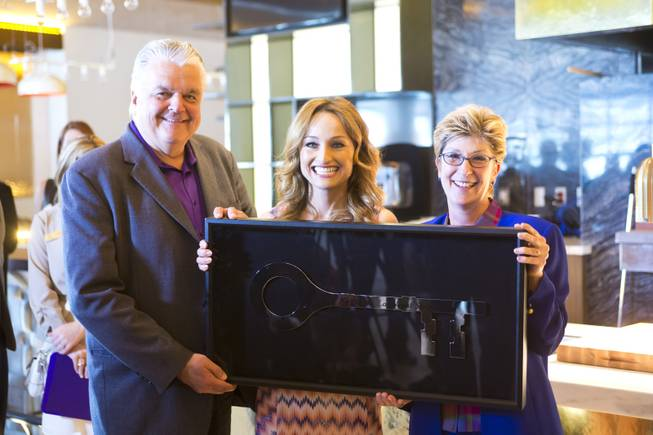 Clark Counry Commissioners Steve Sisolak and Chris Giunchigliani present Giada De Laurentiis with The Key to the Las Vegas Strip during the ribbon-cutting ceremony at The Cromwell, Wednesday May 21, 2014. The Cromwell is the first stand-alone boutique hotel located on the Las Vegas Strip.