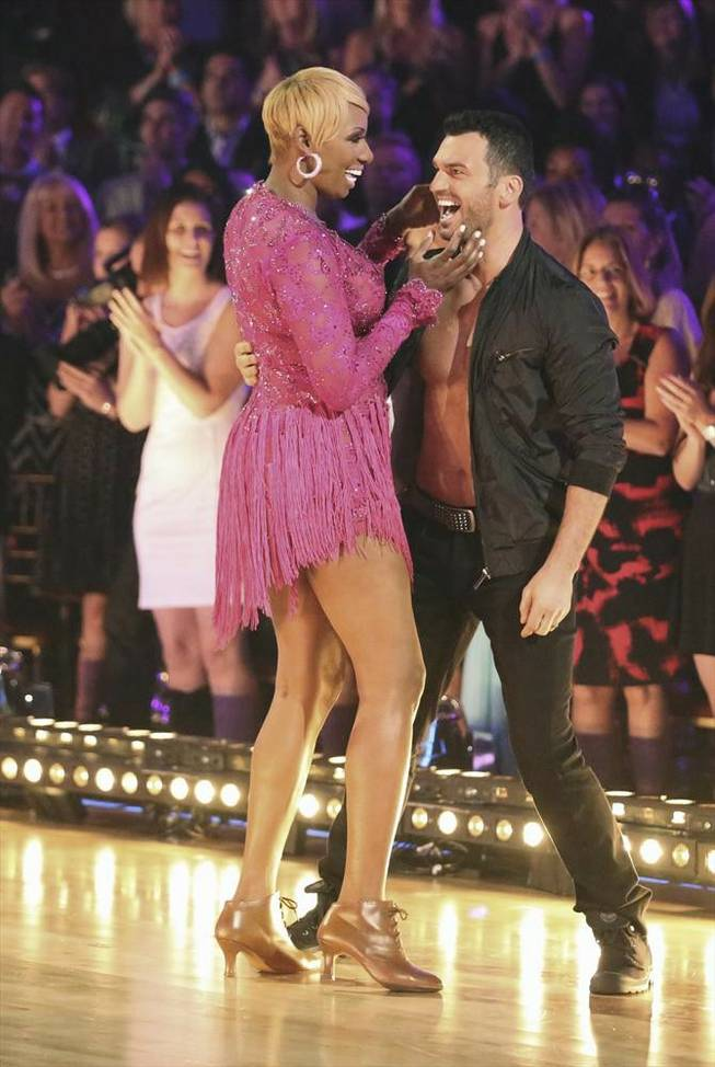 "NeNe Leakes and Tony Dovolani perform on the Season 18 finale of ABC's ""Dancing With the Stars"" on Tuesday, May 20, 2014."