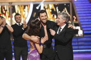 "Maksim Chmerkovskiy and ice dancer Meryl Davis celebrate their Season 18 victory with host Tom Bergeron on ABC's ""Dancing With the Stars"" on Tuesday, May 20, 2014."