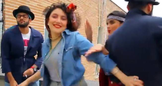 "In this frame grab taken from video posted to YouTube, people dance to Pharrell Williams' hit song ""Happy"" on a rooftop in Tehran, Iran. Police in Iran have arrested six young people and shown them on state television for posting the video. While the song has sparked similar videos all over the world, in Iran some see the trend as promoting the spread of Western culture. And women are banned from dancing in public or appearing outside without the hijab in the Islamic Republic."