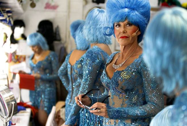 "Karrie France, 57, waits in the dressing room for the start of ""The Fabulous Palm Springs Follies"" in Palm Springs, Calif., on March 27, 2014."