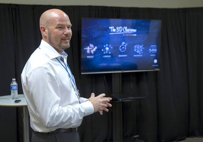"Mattias Bostrom, Sensavis director of product development, prepares to give a demonstration of Sensavis 3D educational software in Las Vegas Wednesday, May 21, 2014. Sensavis, a Swedish education company, is promoting their ""3D classroom,"" which allows students to interact with subjects like human anatomy, math, science and geography in a realistic virtual environment."