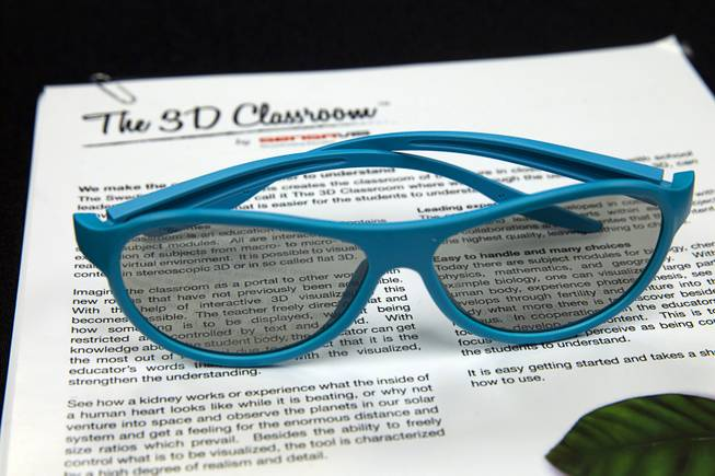 "3-D glasses are shown during a demonstration of Sensavis 3D educational software in Las Vegas Wednesday, May 21, 2014. Sensavis, a Swedish education company, is promoting their ""3D classroom,"" which allows students to interact with subjects like human anatomy, math, science and geography in a realistic virtual environment."