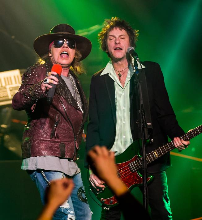 Axl Rose and Tommy Stinson perform during Guns N Roses' An Evening of Destruction, No Trickery!, which marked their return to The Joint at Hard Rock Hotel & Casino to launch their second residency on Wednesday, May 21, 2014.