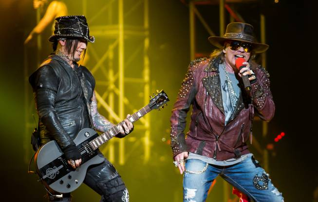 "DJ Ashba and Axl Rose during Guns N' Roses' ""An Evening of Destruction: No Trickery!"" at the Joint in the Hard Rock Hotel on Wednesday, May 21, 2014."