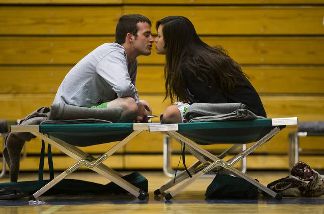 Nathan Westerfield, 22, kisses his new bride, Mickella, 20, at the Red Cross shelter set up at Sinagua Middle School in Flagstaff, Ariz., Tuesday, May 20, 2014.