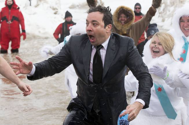 "In this March 2, 2014, file photo, Jimmy Fallon, host of ""The Tonight Show,"" exits the icy waters of Lake Michigan during the ""Polar Plunge"" in Chicago. Fallon was joined Chicago Mayor Rahm Emanuel in the event. Emanuel will now appear on ""The Tonight Show"" with Jimmy Fallon on June 3, making good on his promise after Fallon came to participate in the event."
