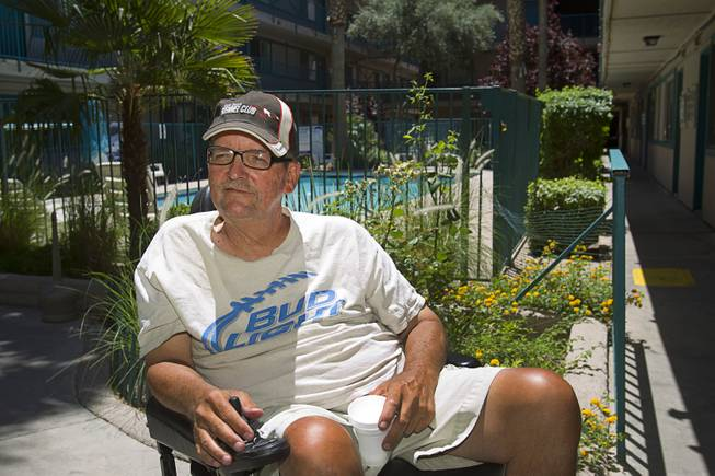 Downtown resident Joe Sennett, 59, originally from Boston, is shown in the courtyard of the Park Avenue Apartments at Seventh Street and Carson Avenue Tuesday, May 15, 2014. STEVE MARCUS