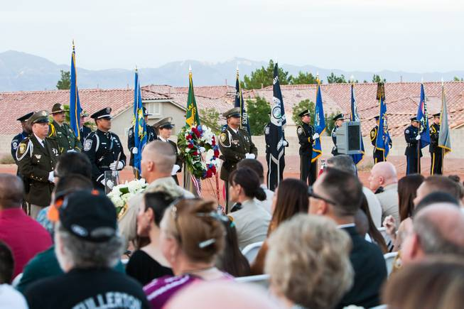 The Nevada Honor Guard presents the colors of each law enforcement agency being honored during the Southern Nevada Law Enforcement Memorial ceremony at Police Memorial Park in Las Vegas Thursday, May 22, 2014.