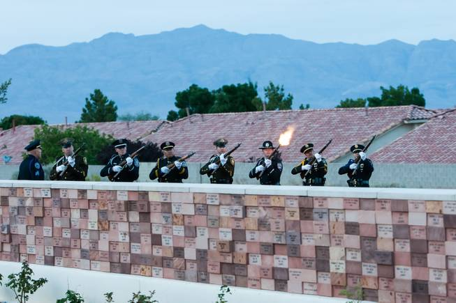 A 21-gun salute is performed in honor of Nevada fallen officers during the Southern Nevada Law Enforcement Memorial ceremony at Police Memorial Park in Las Vegas Thursday, May 22, 2014.