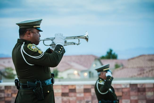 Taps sounds through the air in honor of Nevada fallen officers during the Southern Nevada Law Enforcement Memorial ceremony at Police Memorial Park in Las Vegas Thursday, May 22, 2014.
