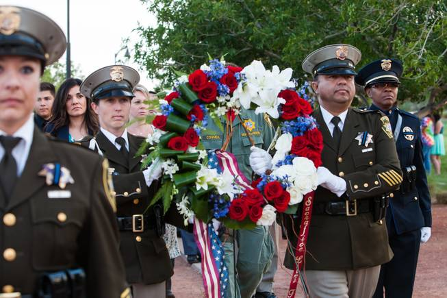 Family members of fallen officer LVMPD Search and Rescue Officer David VanBuskirk follow the memorial wreath during the honor march during the Southern Nevada Law Enforcement Memorial ceremony at Police Memorial Park in Las Vegas Thursday, May 22, 2014.
