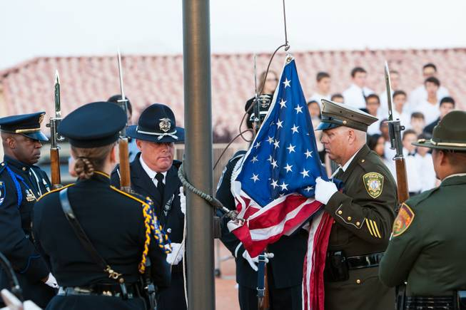 The Nevada Honor Guard raises the American flag to half mast in honor of fallen officers during the Southern Nevada Law Enforcement Memorial ceremony at Police Memorial Park in Las Vegas Thursday, May 22, 2014.