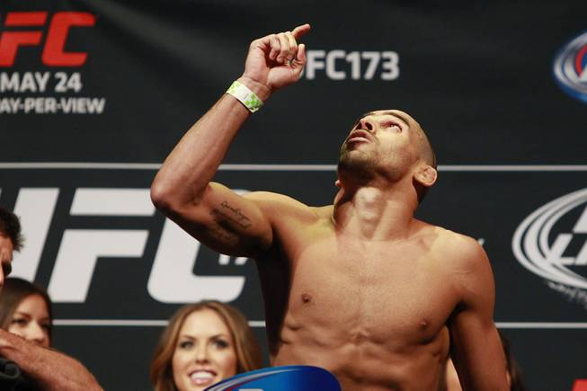 Renan Barao points to the heavens after making weight during the weigh in for UFC 173 Friday, May 23, 2014 at the MGM Grand Garden Arena.