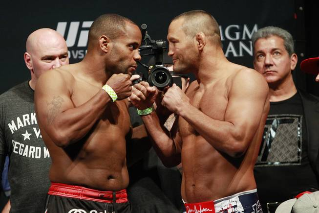 Daniel Cormier and Dan Henderson face off during the weigh-in for UFC 173 Friday, May 23, 2014, at the MGM Grand Garden Arena.