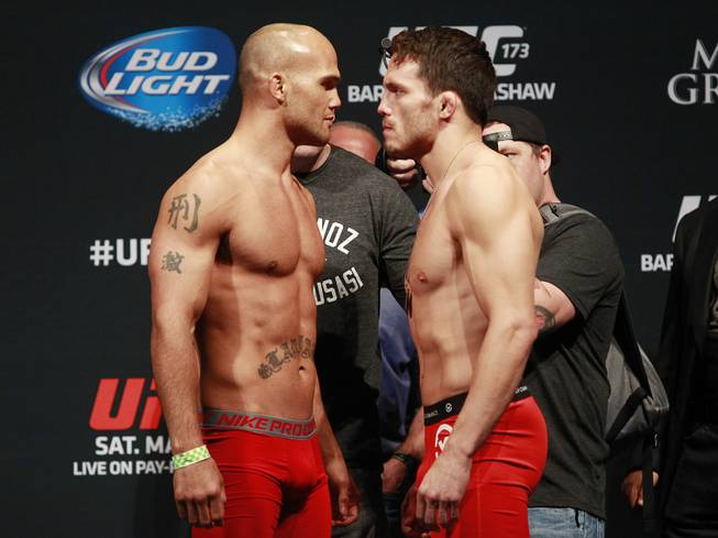 Robbie Lawler.and Jake Ellenberger face off during the weigh in for UFC 173 Friday, May 23, 2014 at the MGM Grand Garden Arena.