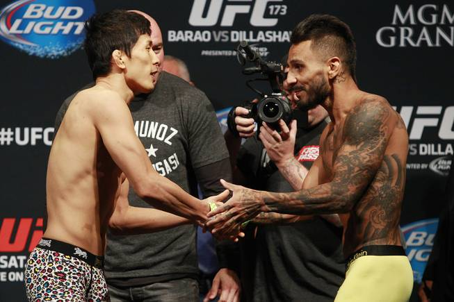 Takeya Mizugaki and Francisco Rivera shake hands during the weigh in for UFC 173 Friday, May 23, 2014 at the MGM Grand Garden Arena.