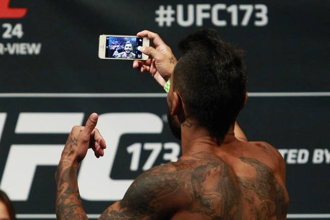Francisco Rivera takes a selfie after making weight during the weigh in for UFC 173 Friday, May 23, 2014 at the MGM Grand Garden Arena.