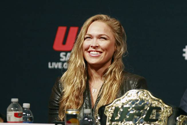 Ronda Rousey smiles during a news conference to promote UFC 175 Friday, May 23, 2014 at the MGM Grand Garden Arena. UFC 175 will be held July 5th, 2014 at the Mandalay Bay Events Center.