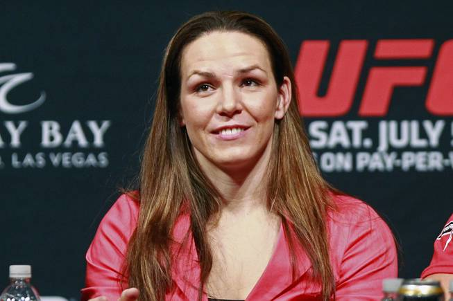 Alexis Davis smiles during a news conference to promote UFC 175 Friday, May 23, 2014 at the MGM Grand Garden Arena. UFC 175 will be held July 5th, 2014 at the Mandalay Bay Events Center.