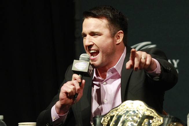Chael Sonnen points to a fan during a news conference to promote UFC 175 Friday, May 23, 2014 at the MGM Grand Garden Arena. UFC 175 will be held July 5th, 2014 at the Mandalay Bay Events Center.