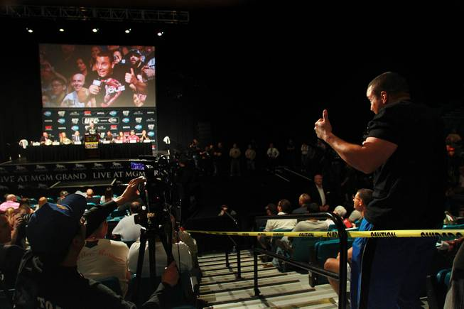 Former UFC fighter Pat Berry sneaks in a final question during a news conference to promote UFC 175 Friday, May 23, 2014 at the MGM Grand Garden Arena. UFC 175 will be held July 5th, 2014 at the Mandalay Bay Events Center.